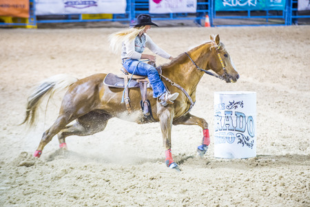 arena rodeo: LAS VEGAS - MAY 16 : Cowgirl Participating in a Barrel racing competition at the Helldorado Days Rodeo , A professional rodeo held in Las Vegas , Nevada on May 16 2015