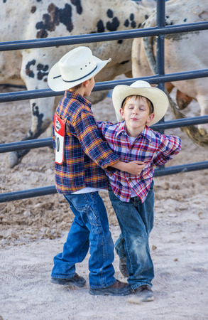 arena rodeo: LAS VEGAS - MAY 16 : Two young Cowboys Participating in the Helldorado days Rodeo , A professional rodeo held in Las Vegas, Nevada on May 16 , 2015