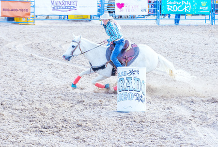 arena rodeo: LAS VEGAS - MAY 17 : Cowgirl Participating in a Barrel racing competition at the Helldorado Days Rodeo , A professional rodeo held in Las Vegas , Nevada on May 17 2015