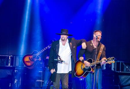 troy: LAS VEGAS - MAY 22 : Eddie Montgomery and Troy Gentry of Montgomery Gentry perform onstage during the Cowboy Spring Break held in the MGM Village in Las Vegas on May 22 , 2015