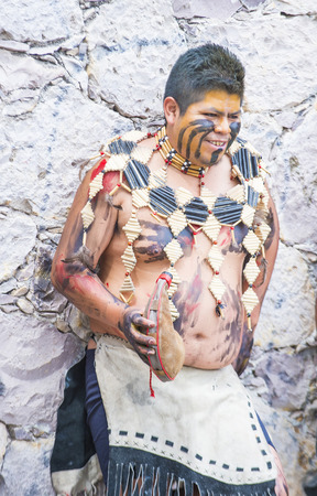 SAN MIGUEL DE ALLENDE , MEXICO - MAY 31 :Native American with traditional costume participates at the festival of Valle del Maiz on May 31 , 2015 in San Miguel de Allende ,Mexico.
