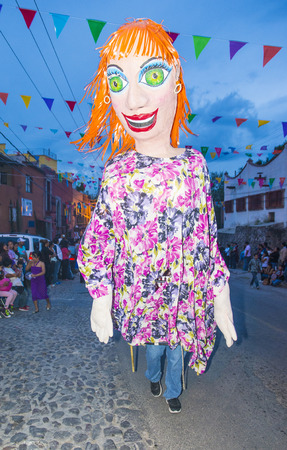 folk heritage: SAN MIGUEL DE ALLENDE , MEXICO - MAY 31 : Mojigangas at the festival of Valle del Maiz on May 31 , 2015 in San Miguel de Allende ,Mexico. Mojigangas are traditional Mexican giant puppets.