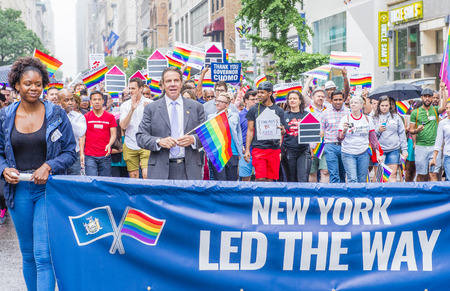 allowing: NEW YORK -  JUNE 28 : Governor Andrew Cuomo in the Gay Pride Parade on June 28, 2015 in New York The parade is held two days after the U.S. Supreme Courts decision allowing gay marriage in the U.S. Editorial