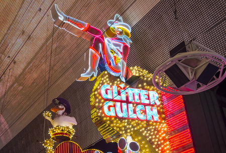 17 20: LAS VEGAS - MAY 17 : Cowgirl neon sign in downtown Las Vegas on May 17 2015. The iconic sign of Glitter Gulch is placed in 20 East Fremont Street, in Downtown Las Vegas