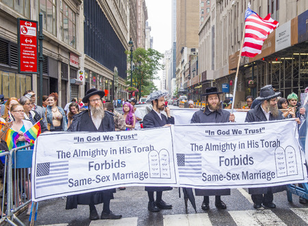 NEW YORK -  JUNE 28 : Orthodox Jews protest again the Gay Pride Parade on June 28, 2015 in New York The parade is held two days after the U.S. Supreme Courts decision allowing gay marriage.