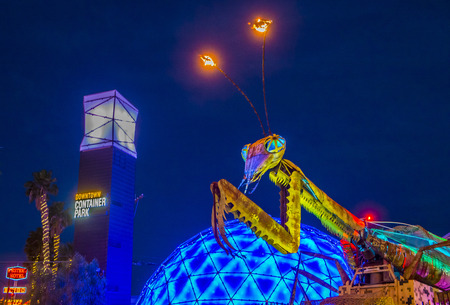 three story: LAS VEGAS - MAY 17 : The Giant Praying Mantis Sculpture in front of Container park in Downtown Las Vegas on May 17 2015. The three story Container Park is made from shipping containers