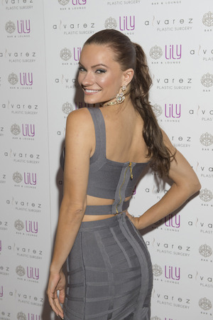 bellagio las vegas: LAS VEGAS - JULY 17 : Model Caitlin OConnor attends a party for Alvarez Plastic Surgery at Lily Bar & Lounge at the Bellagio hotel in Las Vegas, Nevada on July 17 2015.