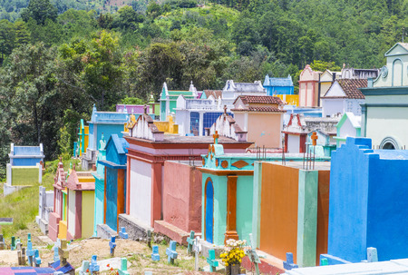 honoring: CHICHICASTENANGO , GUATEMALA - JULY 26 : Colorful Cemetery in Chichicastenango on July 26 2015. in Guatemala family members paint the tombstone as a way of honoring the dead