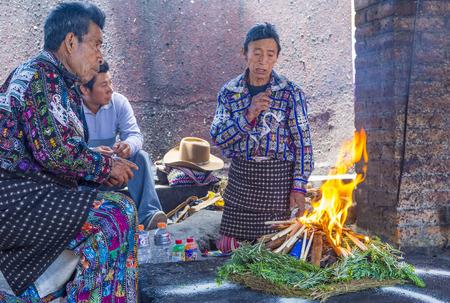 guatemalan: CHICHICASTENANGO , GUATEMALA - JULY 26 : Guatemalan men takes part in a traditional Mayan ceremony in Chichicastenango , Guatemala on July 26 2015
