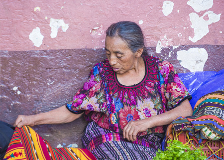 grocery trade: CHICHICASTENANGO , GUATEMALA - JULY 26 : Portrait of an old Guatemalan woman at the Chichicastenango Market on July 26 2015. This native market is the most colorful in Central America Editorial