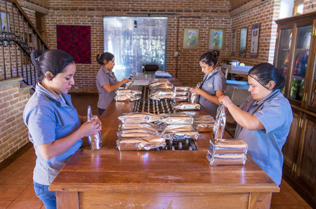 caffiene: ANTIGUA , GUATEMALA - JULY 27 : Guatemalan women work at a coffee packaging factory in Antigua Guatemala on July 27 2015. Coffee is an important element of Guatemalas economy