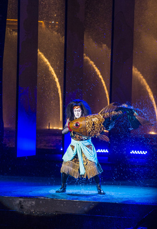 strip dance: LAS VEGAS - AUG 14 : Traditional Japanese Kabuki performance in front of the Bellagio hotel and casino fountains on August 14 2015.