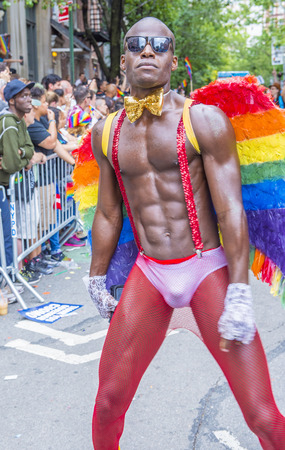 sexy gay: NEW YORK -  JUNE 28 : Participant march in the Gay Pride Parade on June 28, 2015 in New York City The parade is held two days after the U.S. Supreme Courts decision allowing gay marriage in the U.S. Editorial