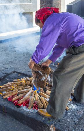 guatemalan: CHICHICASTENANGO , GUATEMALA - JULY 26 : Guatemalan man take part in a traditional Mayan ceremony in Chichicastenango , Guatemala on July 26 2015