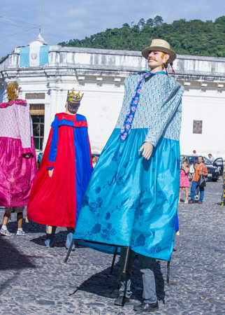 papiermache: ANTIGUA , GUATEMALA - JULY 25 : Mojigangas dance in the street in Antigua Guatemala on July 25 , 2015. Mojigangas are traditional giant puppets.