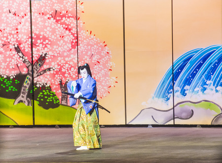 bellagio fountains: LAS VEGAS - AUG 14 : Traditional Japanese Kabuki performance in front of the Bellagio hotel and casino fountains on August 14 2015.
