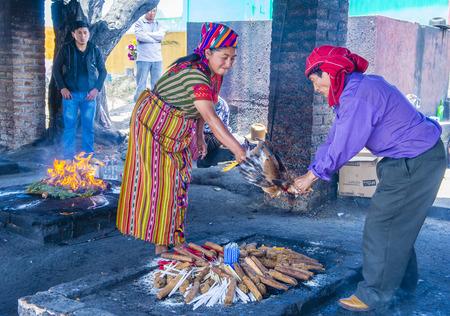 guatemalan: CHICHICASTENANGO , GUATEMALA - JULY 26 : Guatemalan people take part in a traditional Mayan ceremony in Chichicastenango , Guatemala on July 26 2015