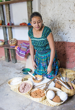 weavers: SAN JUAN LA LAGUNA , GUATEMALA - JULY 28 : Mayan woman weaving in San Juan la laguna , Guatemala on July 28 2015 , Mayan weavers known worldwide for their skills. Editorial