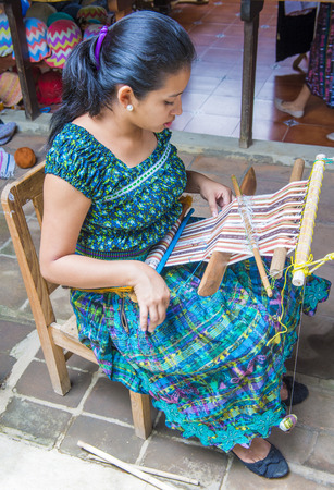 weavers: SAN JUAN LA LAGUNA , GUATEMALA - JULY 28 : Mayan woman weaving with strap loom in San Juan la laguna , Guatemala on July 28 2015 , Mayan weavers known worldwide for their skills. Editorial