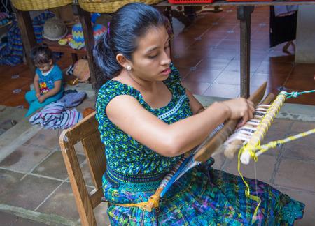 SAN JUAN LA LAGUNA , GUATEMALA - JULY 28 : Mayan woman weaving with strap loom in San Juan la laguna , Guatemala on July 28 2015 , Mayan weavers known worldwide for their skills.