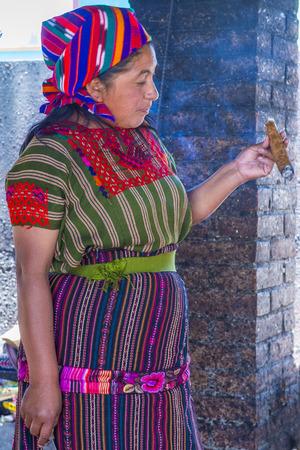 guatemalan: CHICHICASTENANGO , GUATEMALA - JULY 26 : Guatemalan woman take part in a traditional Mayan ceremony in Chichicastenango , Guatemala on July 26 2015