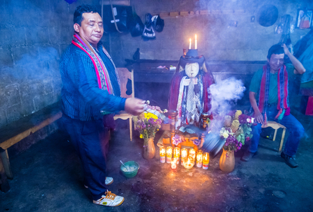 strongest: SANTIAGO DE ATITLAN , GUATEMALA - JULY 28 : Shrine of El Maximon in Santiago De Atitlan , Guatemala on July 28 2015 , Maximon saintdevil is one of the strongest remnants of the Mayan faith Editorial