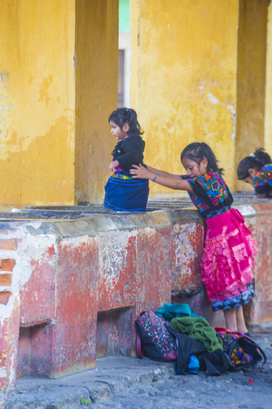 guatemalan: ANTIGUA , GUATEMALA - JULY 30 : Guatemalan girl wash laundry in a traditional street washing facility in Antigua, Guatemala on July 30 2015.