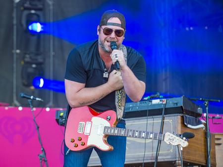 onstage: LAS VEGAS - SEP 19 : Singersongwriter Lee Brice performs onstage at the 2015 iHeartRadio Music Festival at the Las Vegas Village on September 19, 2015 in Las Vegas, Nevada.