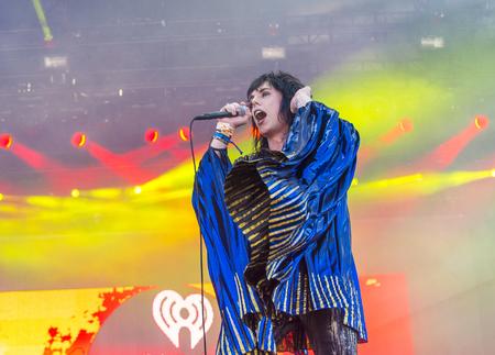 struts: LAS VEGAS - SEP 19 : Singer Luke Spiller of The Struts performs onstage at the 2015 iHeartRadio Music Festival at the Las Vegas Village on September 19, 2015 in Las Vegas, Nevada.