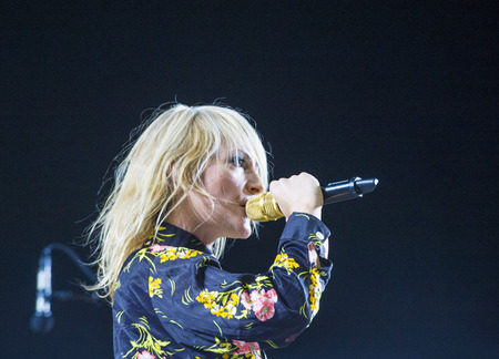 metric: LAS VEGAS - SEP 25 : Musician Emily Haines of Metric performs onstage during day 1 of the 2015 Life Is Beautiful Festival on September 25, 2015 in Las Vegas, Nevada.