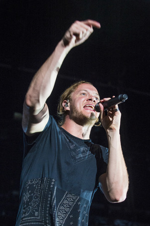 reynolds: LAS VEGAS - SEP 26 : Dan Reynolds of Imagine Dragons performs on stage at the 2015 Life is Beautiful festival on September 26, 2015 in Las Vegas, Nevada.
