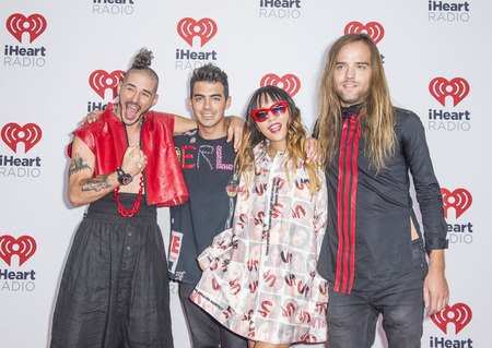 whittle: LAS VEGAS - SEP 19 : Musicians (L-R) Cole Whittle, Joe Jonas, JinJoo Lee and Jack Lawless of DNC attends the 2015 iHeartRadio Music Festival on September 19, 2015 in Las Vegas, Nevada. Editorial