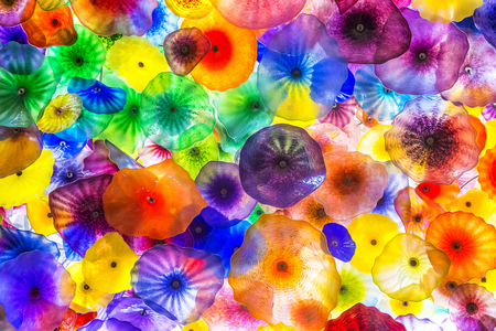 comprised: LAS VEGAS - OCT 15 : The Hand Blown Glass Flower Ceiling at the Bellagio Hotel on October 15, 2015 in Las Vegas. is comprised of 2,000  glass blossoms by glass sculptor Dale Chihuly