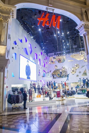 fancy bag: LAS VEGAS - OCT 15 : An H&M store in Las Vegas strip on October 15, 2015. H&M is a Swedish multinational retail-clothing company.