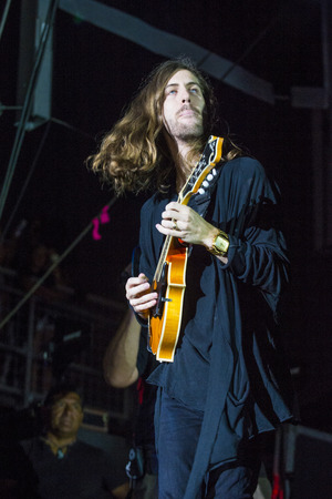 sermon: LAS VEGAS - SEP 26 : Daniel Wayne Sermon of Imagine Dragons performs on stage at the 2015 Life is Beautiful festival on September 26, 2015 in Las Vegas, Nevada. Editorial