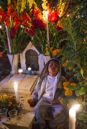 oaxaca: OAXACA , MEXICO - NOV 02 : Unidentified boy on a cemetery during Day of the Dead in Oaxaca, Mexico on November 02 2015. The Day of the Dead is one of the most popular holidays in Mexico