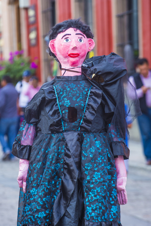 oaxaca: OAXACA , MEXICO  - NOV 02 : Mojiganga at the carnival of the Day of the Dead in Oaxaca, Mexico, on November 02 2015. Mojigangas are traditional Mexican giant puppets. Editorial