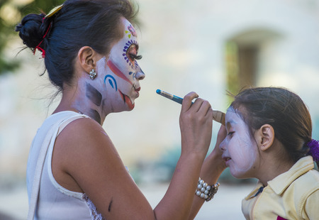 oaxaca: OAXACA , MEXICO - NOV 02 : Unidentified participant has his face covered with makeup on a carnival of the Day of the Dead in Oaxaca, Mexico on November 02 2015. Editorial