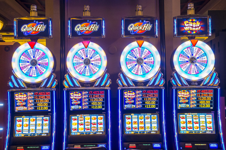 LAS VEGAS - NOV 17 : Slot machines at Mandalay Bay casino on November 17, 2015 in Las Vegas. The resort, which opened in 1999, has 3,309 hotel rooms, 24 elevators and a casino of 135,000 sq ft