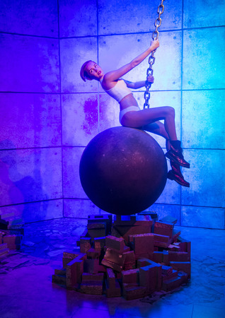 display figure: LAS VEGAS - OCT 23 : A waxwork of Miley Cyrus at The Madame Tussauds museum in Las Vegas on October 23 2015 , The two-floor 30,000-square-foot museum has 100-plus wax replicas.