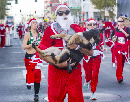 x sport: LAS VEGAS - DEC 05 : An Unidentified participants at the Las Vegas Great Santa Run on December 05 2015 in Las Vegas Nevada. It is the largest gatherings of Santa runners in the world.