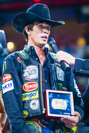 finals: LAS VEGAS - OCT 24 : J.B. Mauney Being interviewed on stage after winning the PBR bull riding world finals. The bull riding world championship held in Las Vegas Nevada on October 24 2015