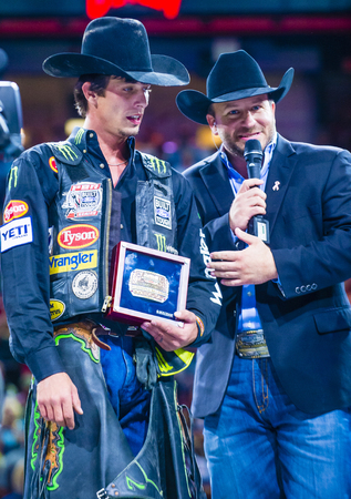 interviewed: LAS VEGAS - OCT 24 : J.B. Mauney (L) Being interviewed on stage after winning the PBR bull riding world finals. The bull riding world championship held in Las Vegas Nevada on October 24 2015