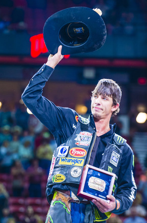 LAS VEGAS - OCT 24 : J.B. Mauney on stage after winning the PBR bull riding world finals. The bull riding world championship held in Las Vegas Nevada on October 24 2015