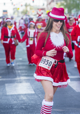 x sport: LAS VEGAS - DEC 05 : An Unidentified participant at the Las Vegas Great Santa Run on December 05 2015 in Las Vegas Nevada. It is the largest gatherings of Santa runners in the world.