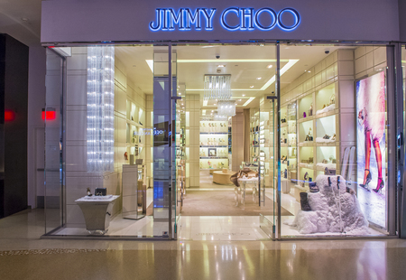 high end: LAS VEGAS - DEC 18 : Exterior of a Jimmy Choo store in Las Vegas strip on December 18 , 2015.  Jimmy Choo is a Malaysian fashion designer and he is well known for his expensive high end shoes.