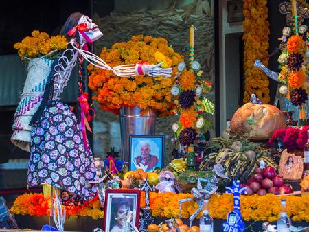 OAXACA , MEXICO - NOV 02 : Traditional Mexican altar installation at the Dia De Los Muertos celebration in Oaxaca , Mexico on November 02 2015