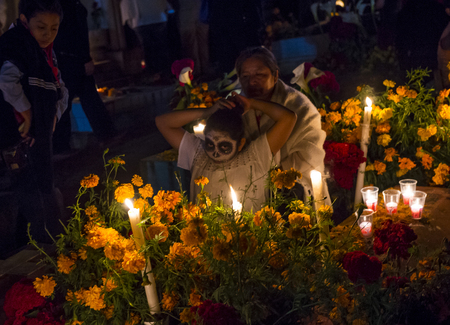 oaxaca: OAXACA , MEXICO - NOV 02 : Unidentified people on a cemetery during Day of the Dead in Oaxaca, Mexico on November 02 2015. The Day of the Dead is one of the most popular holidays in Mexico