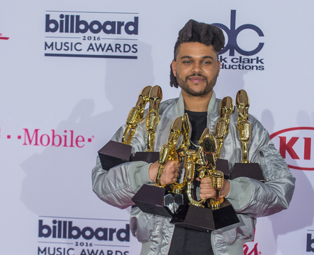 LAS VEGAS - MAY 22 : Recording artist The Weeknd poses in the press room at the 2016 Billboard Music Awards at T-Mobile Arena on May 22, 2016 in Las Vegas, Nevada.