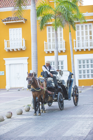 horse drawn carriage: CARTAGENA , COLOMBIA - FEB 04 :  A Horse drawn carriage in Cartagena Colombia on Februery 04 2016. The historic port city Cartagena is UNESCO World Heritage Site since 1984.